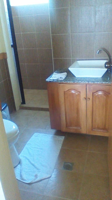 Clean, private bathroom with shower