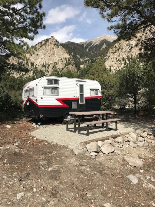 Why camp when you can GLAMP? Vintage camper nestled under the Chalk Cliffs, on 2.5 acres of private property.  Less than 3 miles west of  Mt. Princeton Hot Springs! Hiking, Rafting, 4-Wheeling, Ghost Towns, Dining, and Shopping close by. Explore the Collegiate Peaks and majestic beauty of the Rocky Mountains by day, and glamp under the stars by night. Primitive potty and no electricity, but plenty of charm.