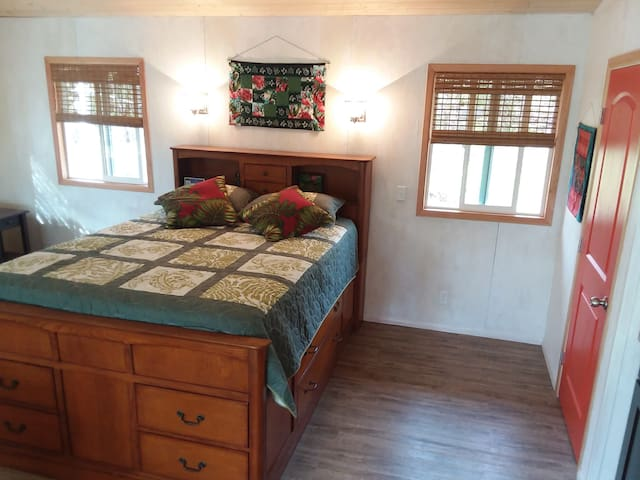 Hardwood queen-sized captain's bed with plenty of drawer space.