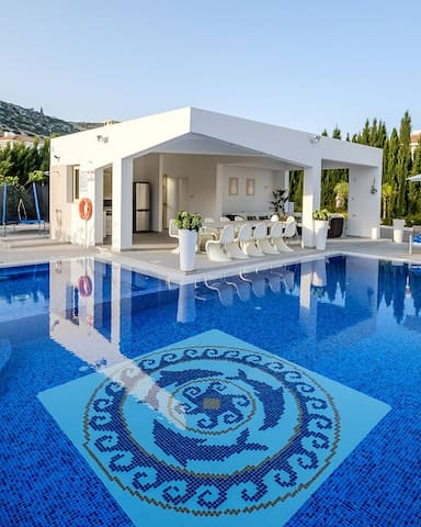 Villa Royale  outdoor terrace with pool view.