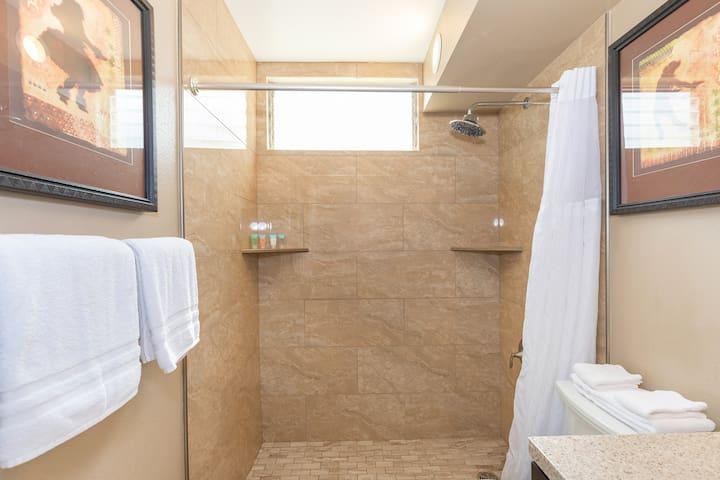 Bathroom features tiled walk-in shower