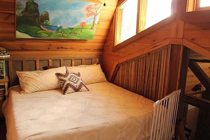 Comfortable king bed upstairs.