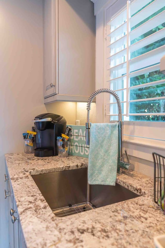 Bungalow Kitchen Area (Keurig Coffee Maker with Mugs and Assorted Breakfast Bars).  Coffee pods, teas and sweetners located in drawer below.