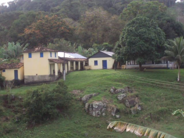 The outbuilding with the blue door is the quest dormitory, left the main house and with magnificent view.