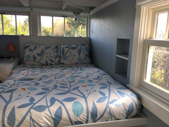 Bed and windows at the treetops
