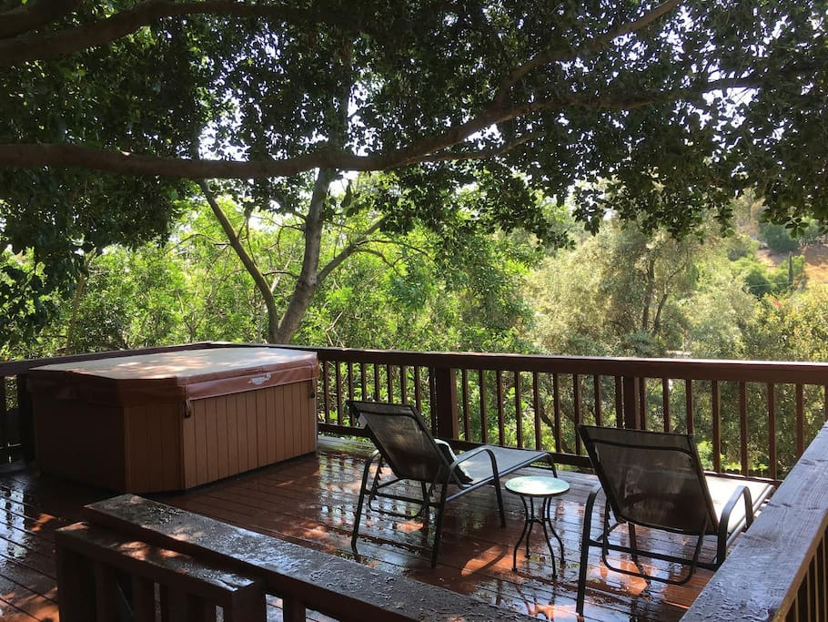 Relax under our oak tree after a nice hot soak in the Jacuzzi