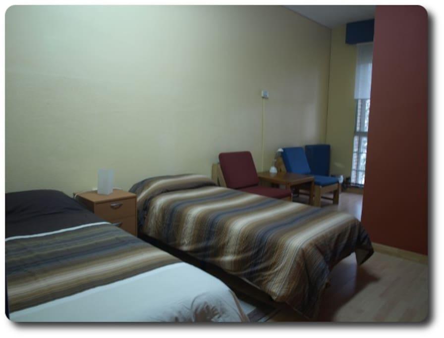 Detalle de camas de una de las habitaciones.