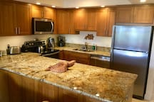Bamboo cabinets, granite counters in kitchen.