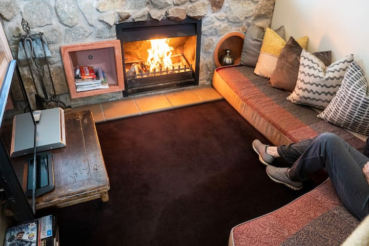Cosy sunken lounge with open fire for winter stays