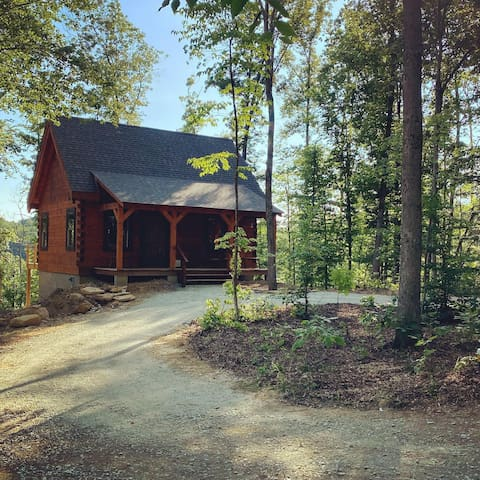 Hand hewn private log cabin with views.