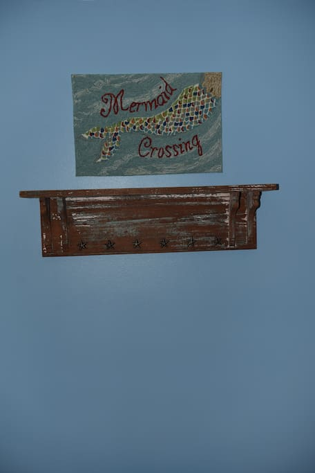 Mermaid Crossing                entry with antique                mantel coat rack