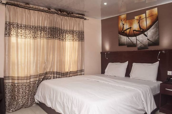 Elegantly furnished rooms with AC, TV, WiFi & More
