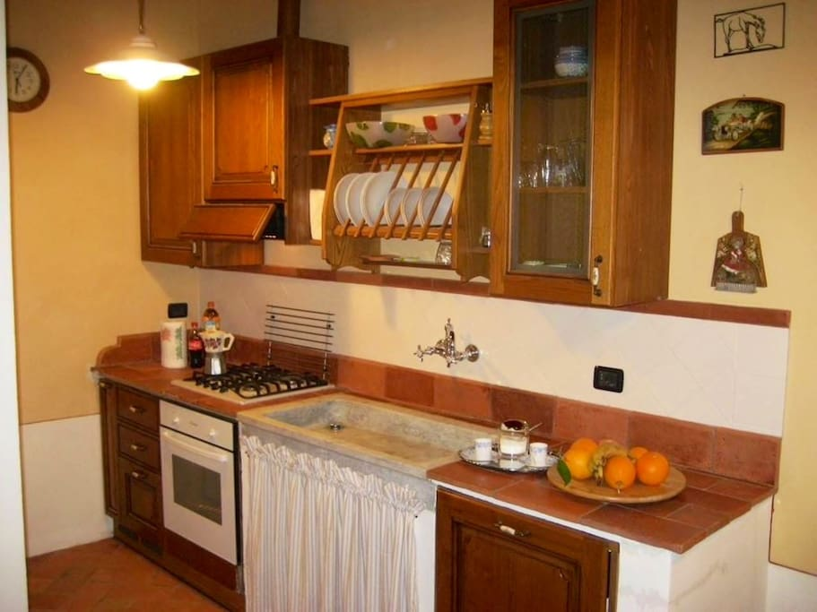 Well equipped kitchen with oven, dishwasher, coffee machine, toaster and kettle.