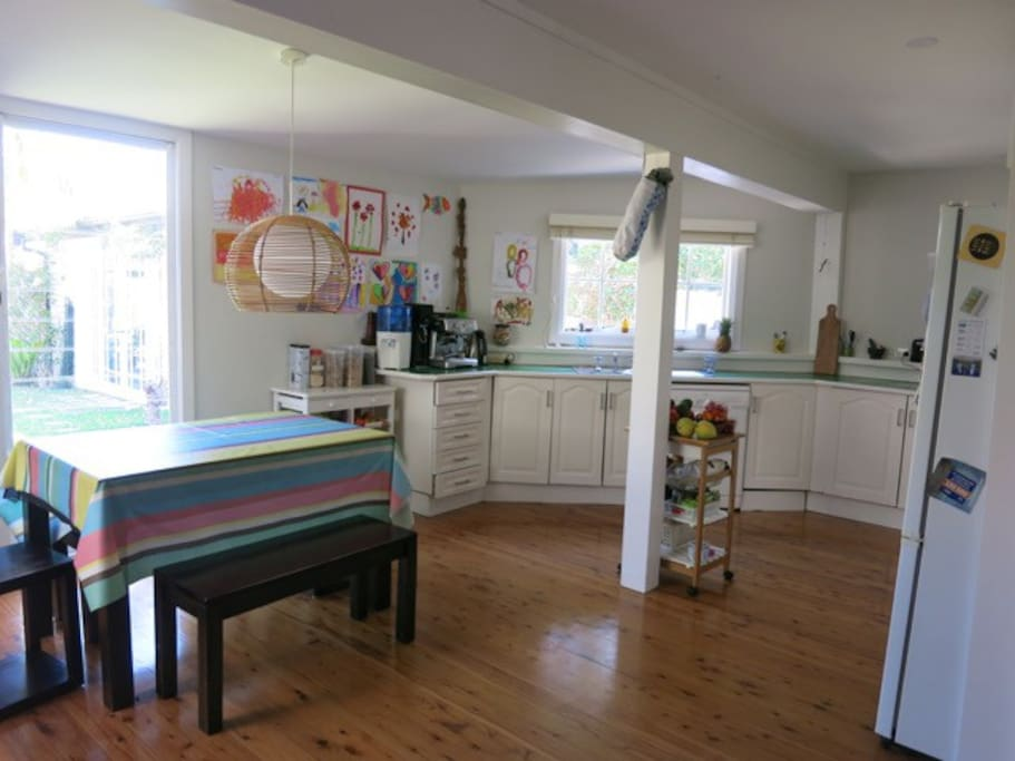 Spacious kitchen with multiple appliances including barista style coffee machine
