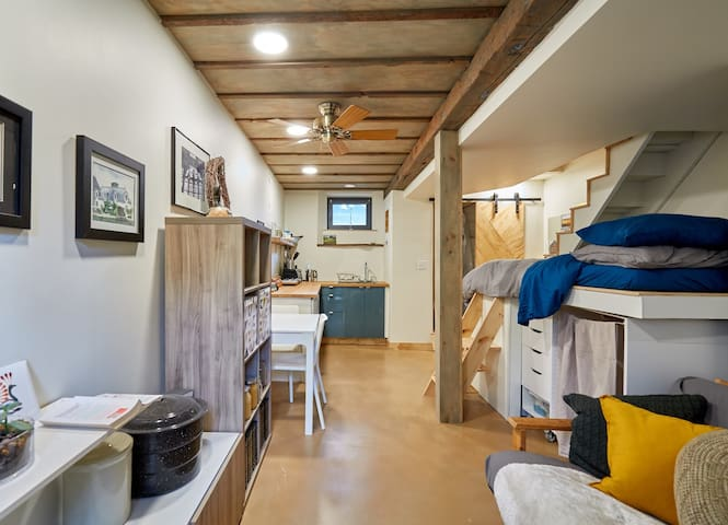 Our guest suite is inspired by the tiny house movement where everything has been well designed