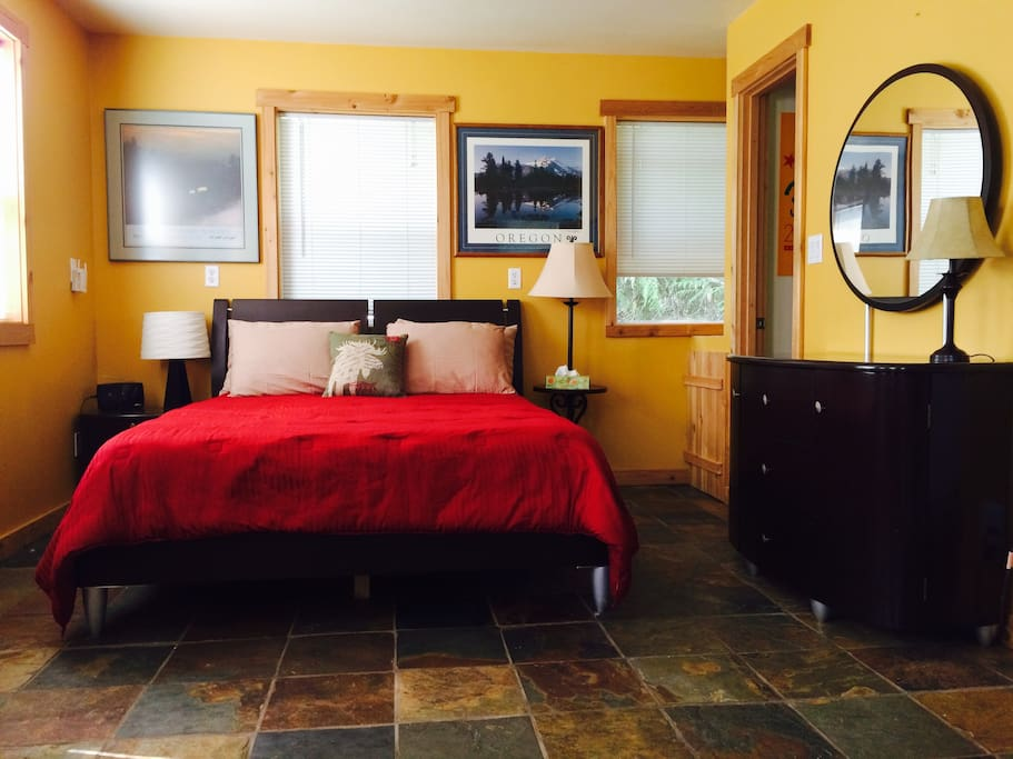 Queen bed with 100% cotton linens, slate floors and lots of windows!