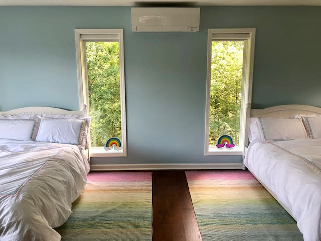 Second bedroom with two double beds and two twin trundles