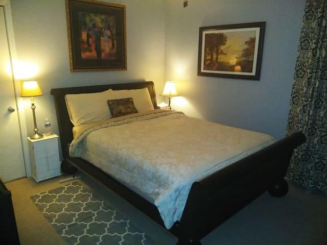West bedroom is 15'x11' with queen bed.