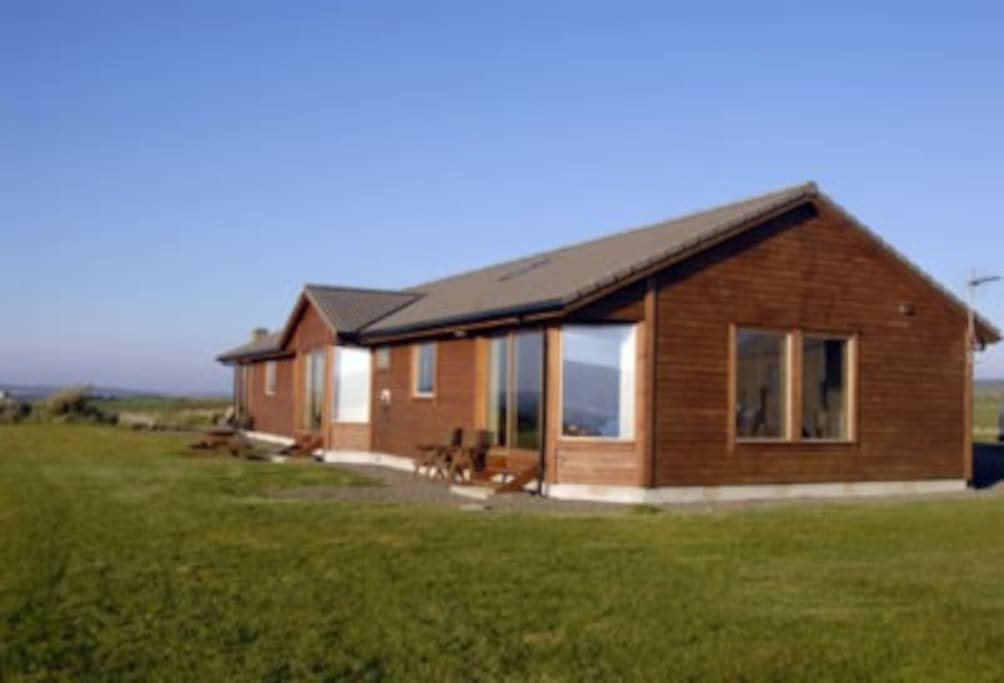 Back view of the chalets.  Large picture glass windows look out to Scapa Flow