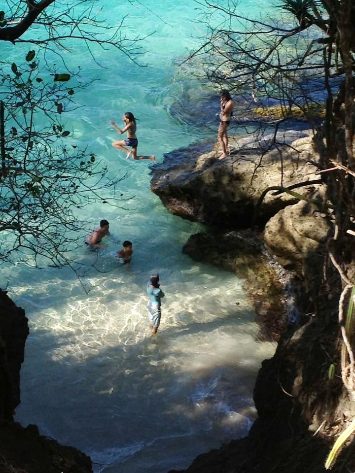 Enjoy a carefree frolic on Princess Margaret Beach an easy stroll from Tropical Daze Villa.