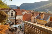 Upper terrace - a perfect place to enjoy sunrise and sunset, or just a cup of coffee with a view over Kotor Bay, scenic mountains and red rooftops of Old Town