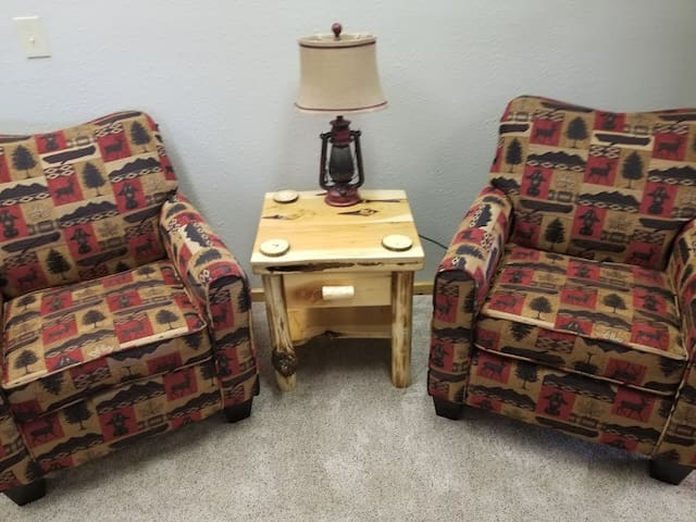 Just outside of the tv areas is a perfect area to visit or read. This area has a unique juniper log end table that makes it a perfect place for you to relax with your morning coffee and a book.