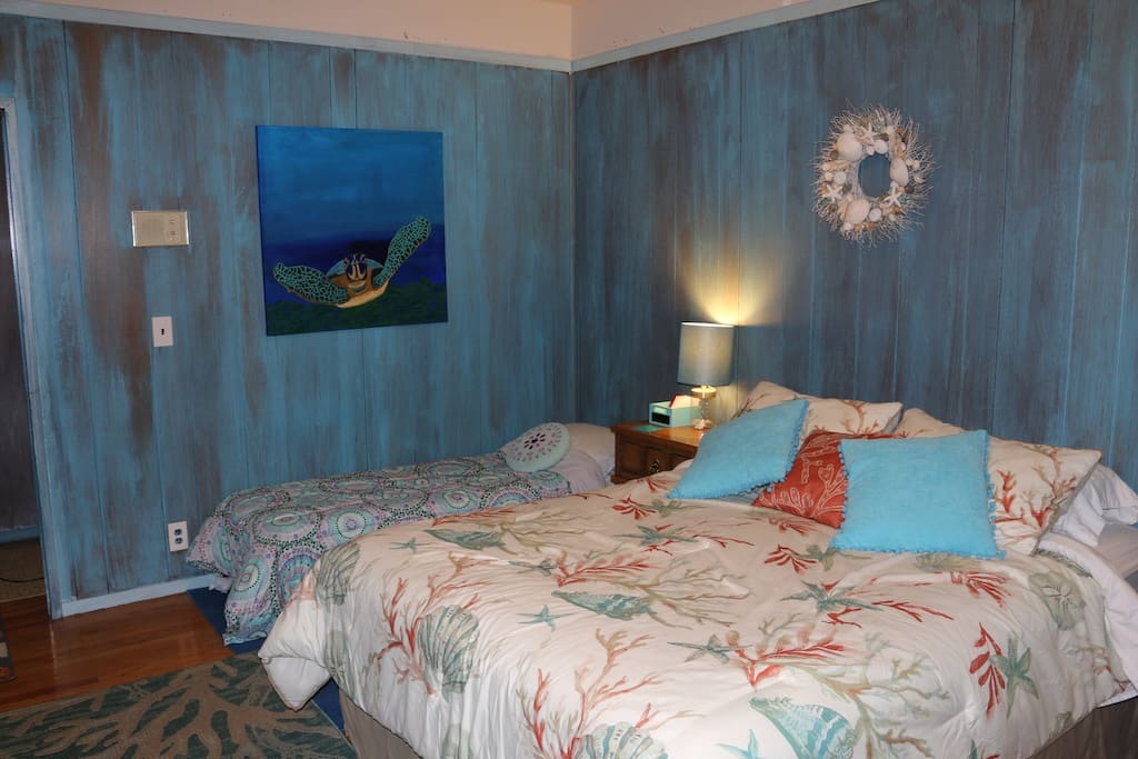 A cozy ocean themed room with extra space to add single beds!