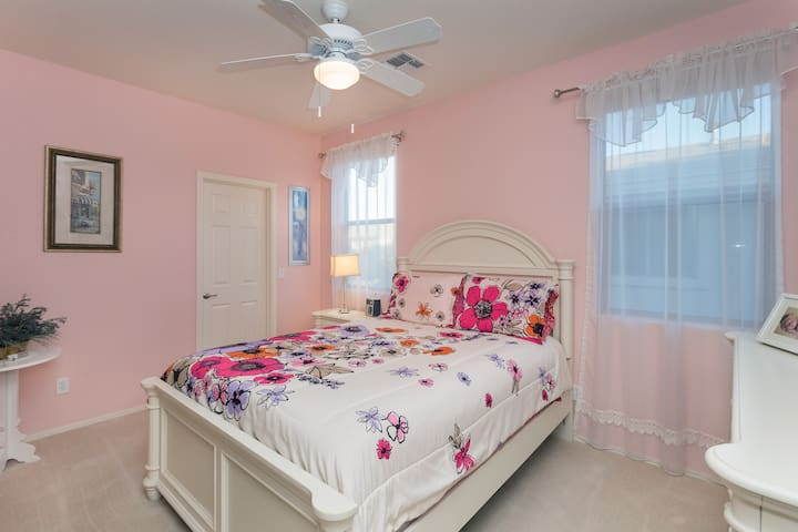 Queen size bedroom with memory foam mattress and attached walk-in closet