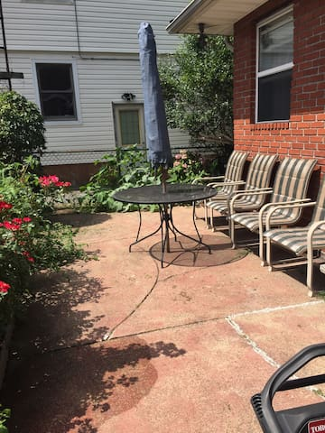 The backyard, entrance to room.
