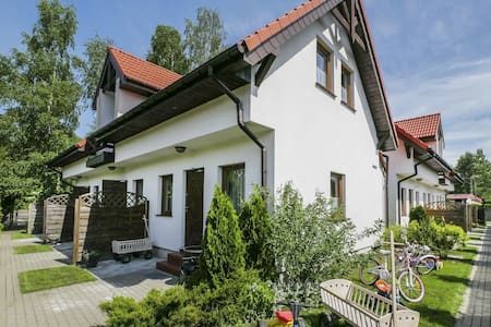 Quaint Holiday Home in Gleznowo with Parasol