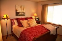 2nd bedroom upstairs has a comfy, queen-sized mattress, lovely views from the window & spacious walk-in closet.