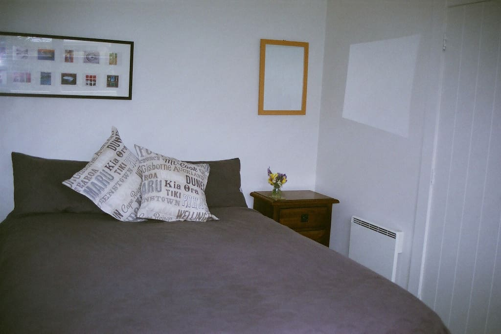Queen sized comfortable bed. Light and airy room.Wardrobe and side bed tables, heater and electric blankets.