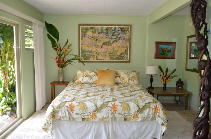King size bed with Beautiful Artwork and Tropical View