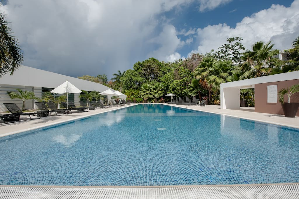 Pool at Club House, perfect to enjoy it after  the gym, sauna or steam room. A few steps from the spa and our building.