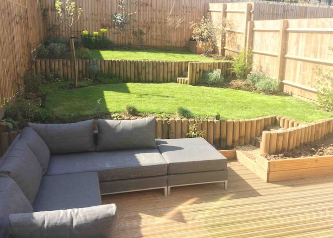 Garden from kitchen with large seating area