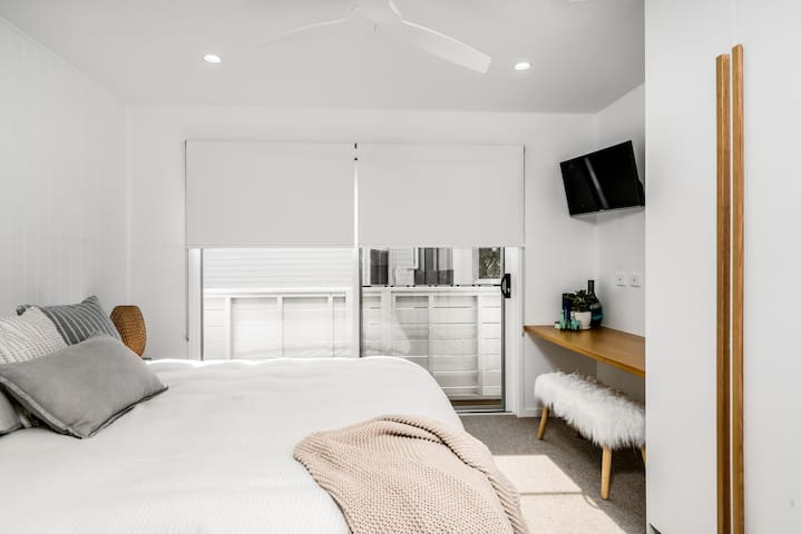 The Master Bedroom features a King Sized bed, workspace and ensuite bathroom