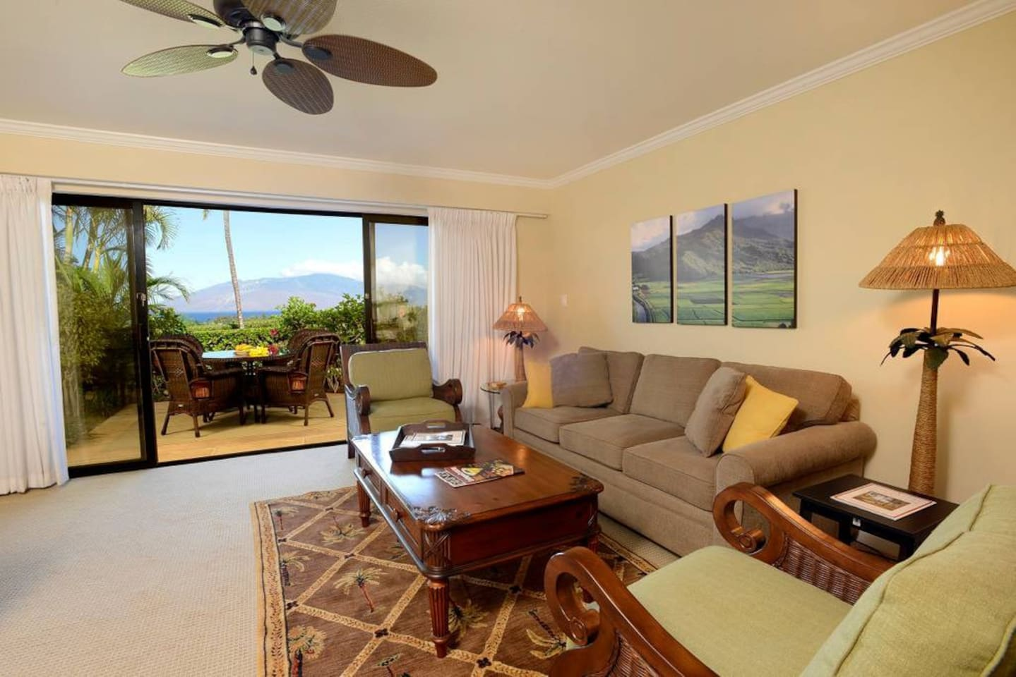 Lovely living room with flat screen television, wall to wall view to  lanai, ocean view to Lanai and West Maui mountains.