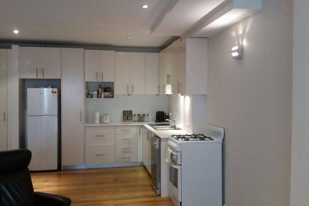Large kitchen with microwave, gas oven, coffee machine and all pots and pans !
