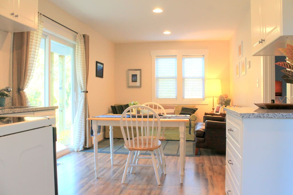 Spacious living room and kitchenette, with plenty of natural light.