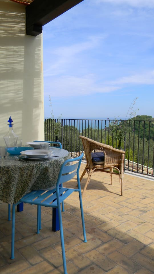 Terrace with table and seating for 6 and sea view.
