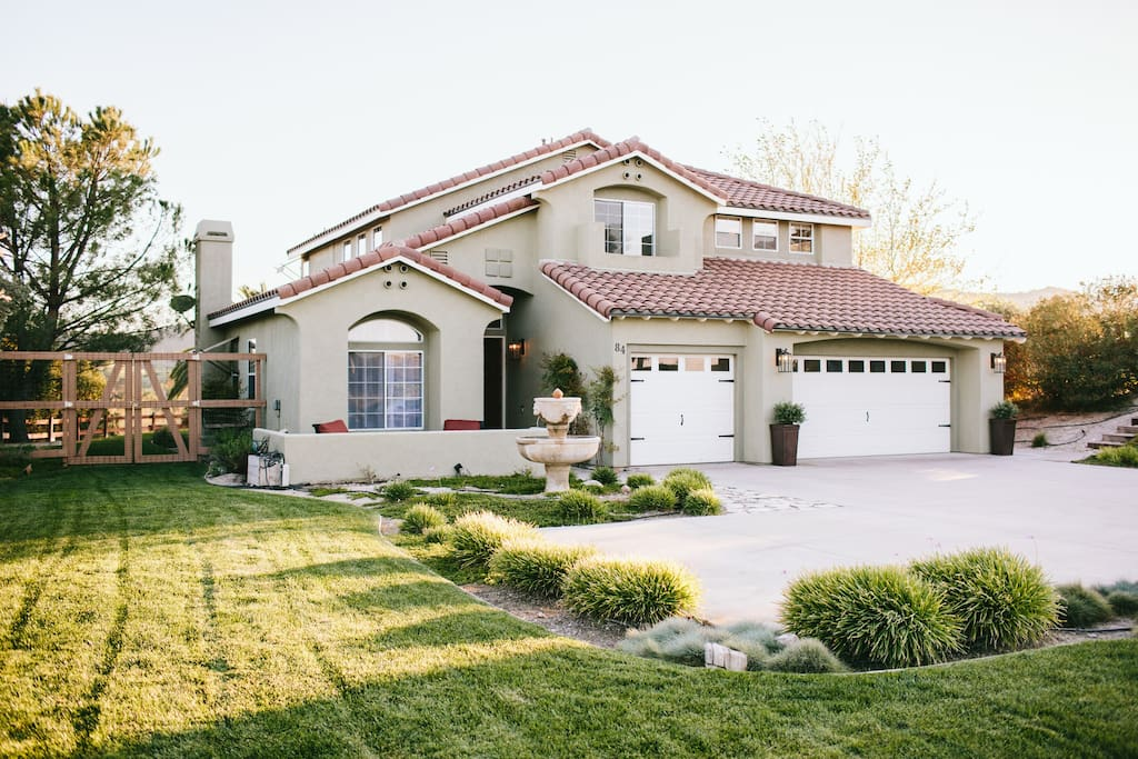 Large Spanish Home with large front yard and plenty of Parking