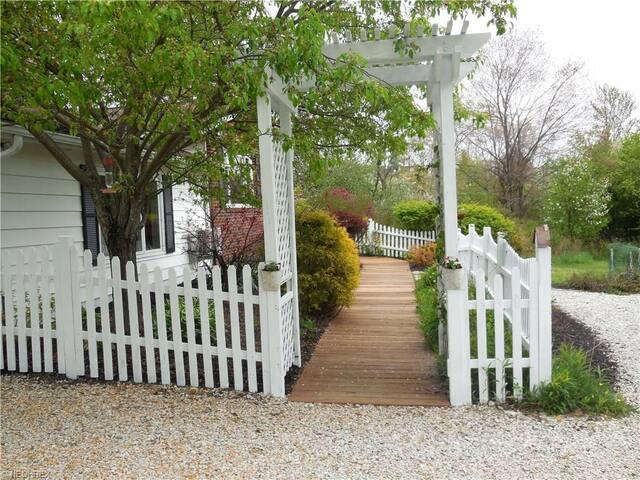 White Picket fence walkway to front door
