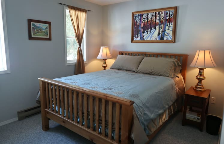 Master bedroom with  queen sized bed and small bedroom attached