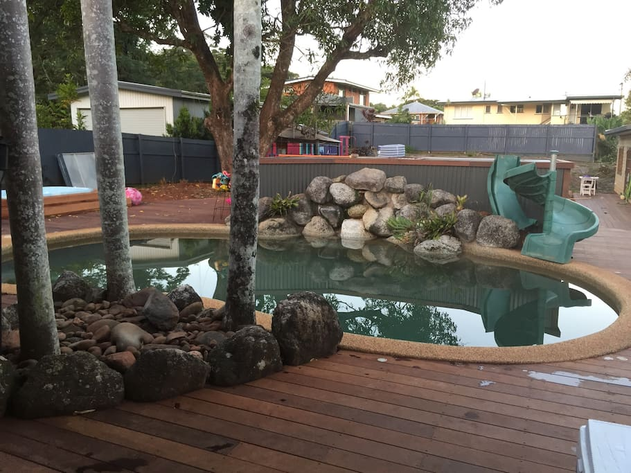 Our refreshing Swimming pool and deck area (slippery slide was not constructed in this photo).  Perfect for keeping cool during the HOT HOT Cairns summers!