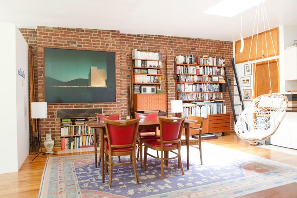 studio living space with the view to the dining table & library