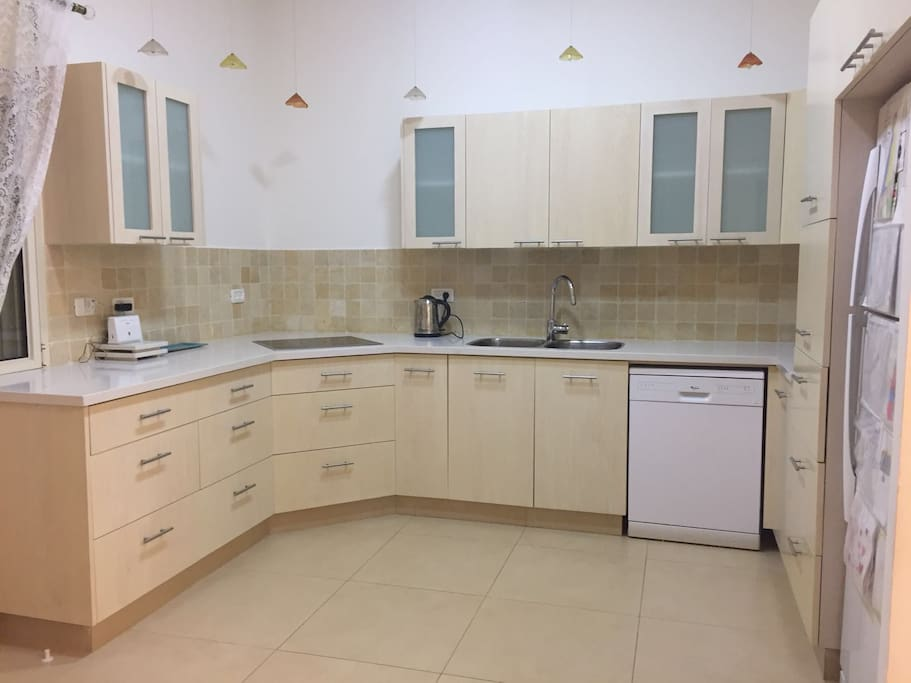 Beautiful large kitchen- refrigerator, dishwasher, oven,toaster oven, microwave, ceramic hob, electric kettle