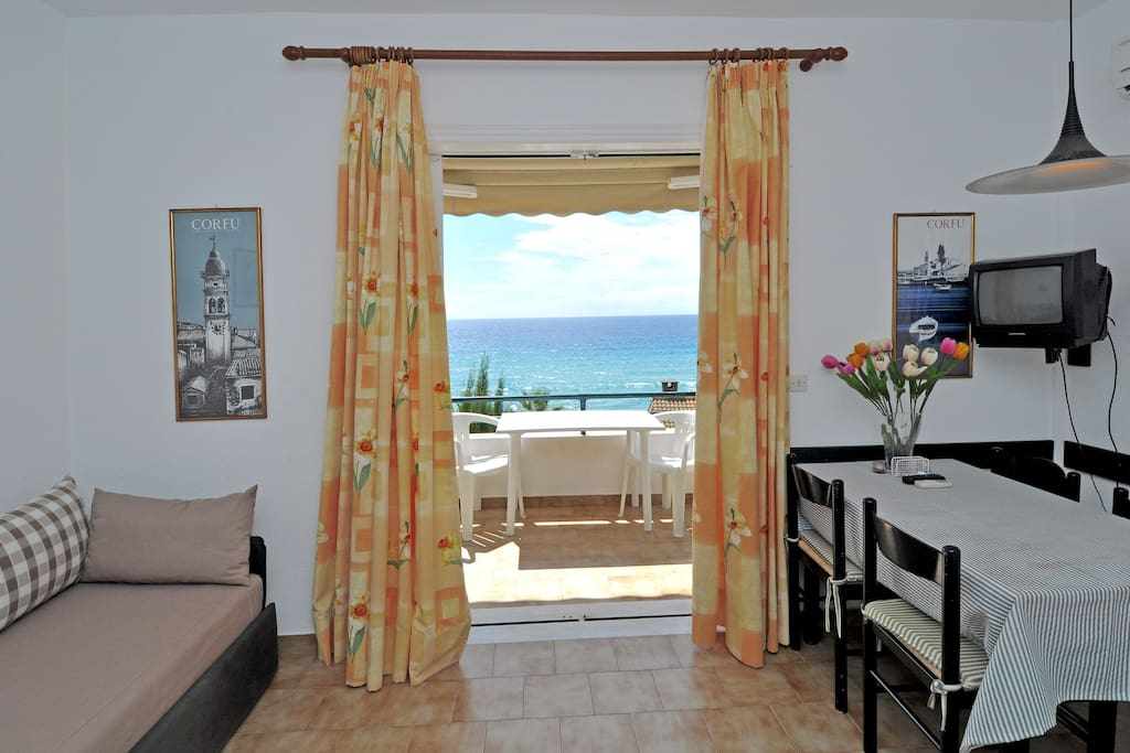 Dining, sitting room and balcony with amazing sea view.