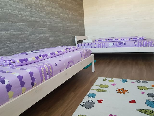 One room with two separate beds