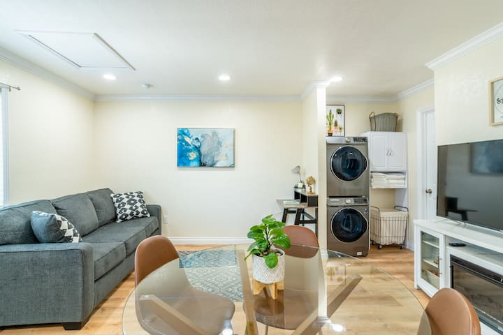 Living/ dining area with 55 in TV.