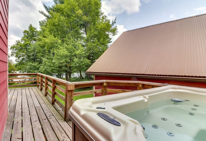 Lakefront cabin w/ private dock, hot tub, & game room - dogs okay!